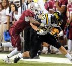 Snider's Addison Dellinger is tackled by Lawrence Central's Delon Pettiford. Photo by Rob Edwards