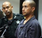 "George Zimmerman, right, stands with a Seminole County Deputy during an April court hearing in Sanford, Fla.  Zimmerman was charged with second-degree murder in the shooting death of ""7-year-old Trayvon Martin. Zimmerman claimed self-defense in the killing, which shocked and angered many across the nation. Photo by The Associated Press"